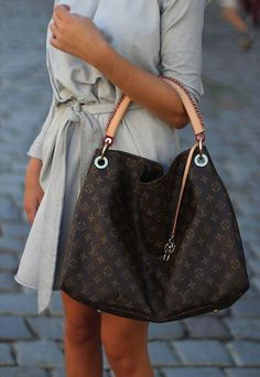 Love this bag....  Louis Vuitton...I need to upgrade :)