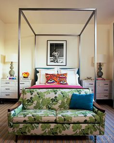 The canopy guest bed and the vintage love seat's upholstery fabric are by Dunham, the bamboo chests and ceramic lamps are vintage, and the carpet is by Patterson, Flynn & Martin