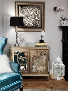 A peacock blue armchair provides a pop of color in this eclectic living room design.