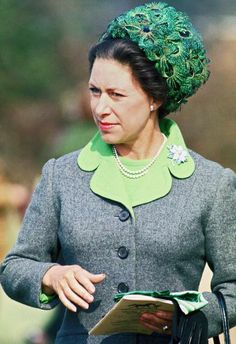 April 17, 1971 Princess Margaret wore this oversize pillbox covered with peacock feathers to Pony Day at Ascot