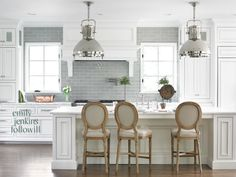 Love the white cabinets and gray tile.