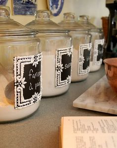 I love that the chalkboard paint makes these jars easy to know what's inside, while the DecoArt Thick Texture Paint creates a border that adds visual interest most chalkboard labels don't offer. #diy #crafts #project #chalkboard #canister #jar #storage