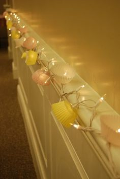 cupcake liners + string lights = cute party decoration