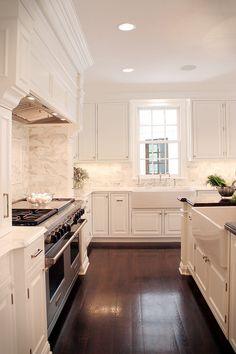 Marble backsplash with white cabinets.