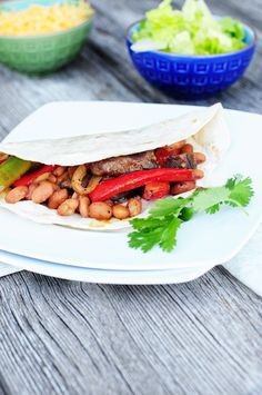 The addition of Bush's Beans Pinto Beans with Bacon make these Steak Fajitas a great summer dish!