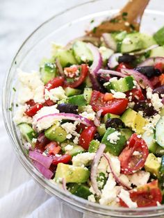 Greek Salad with Avocado has all the classic flavors with the creamy goodness of avocado on FoodieCrush.com #recipe #salad #cucumbers #tomato