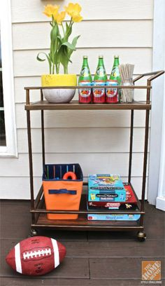 An outdoor bar cart with drinks and games keeps everything organized for adults and kids. Blogger Erika Ward has more practical ideas for making your deck family-friendly and ready for outdoor dining. Just click through. || @ mrserikaward