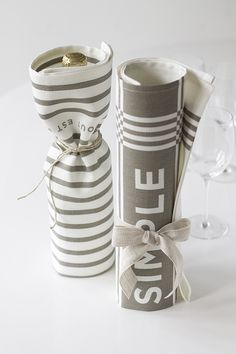 champagne or olive oil wrapped in tea towels (gift idea)