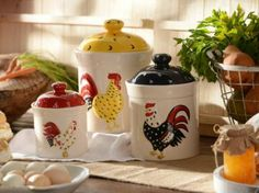 An adorable accent for your farmhouse kitchen, this set of three ceramic rooster canisters features hand-painted embellishments and bold colors! #kirklands #FrenchCountryDining #rooster #canister