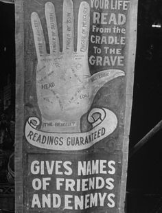 Sign for READINGS GUARANTEED/ YOUR LIFE READ FROM THE CRADLE TO THE GRAVE w. hand chart drawing, advertising sideshow palm reader at carnival in the Greenbrier Valley Fair. Lewisburg, WV, US August 1938