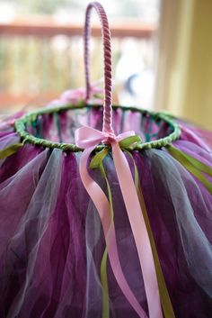 """How to make a pretty tutu basket using a wire basket, tulle and ribbon.  Found on """"Organized  Chaos"""" : DIY: Easter Basket Extreme Cuteness"""