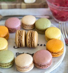 Parting gifts can be a sweet and simple way to show guests your appreciation for their coming to your #ParisEscape soiree.  Find your favorite bakery in town and order a few dozen French Macaroons in various colors.  Line them up on your vintage plates, or package them in cute boxes for guests to grab as they go. #ParisCalling #5onFriday