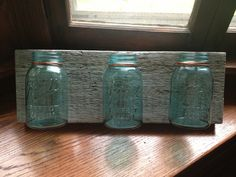 Decorative wall piece - made of reclaimed barn wood and used copper wire to attach vintage Ball canning jars #blue