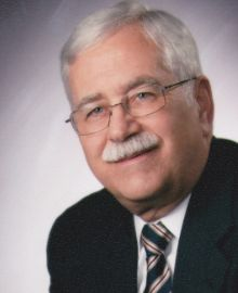 """Arthur Rusch; SD Native, graduate of USD School Law; practiced law for 22 years in Vermillion; served 4 terms as States Attorney; sat on South Dakota Supreme Court; wrote """"County Capitols: The Courthouses of South Dakota"""""""