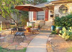 A beautifully hardscaped home has the ultimate curb appeal! Start planning your outdoor oasis to enjoy for yourself, or to up your home's value #hardscaping flagston patio, front patio, side yards, front yards