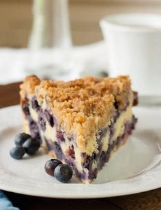 Blueberry Buckle is a gorgeous cross between a cakey cobbler and a coffee cake, topped with some sort of streusel or crumble, which makes it all the more similar to coffee cake.