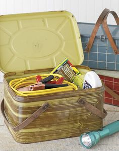Use a vintage tin picket basket as a car emergency kit. Fill with jumper cables, road flares, and a first aid kit.