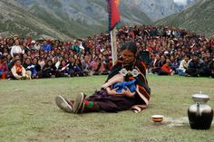 Tashi role-playing a delivery at the Shey Gompa Festival, Dolpa