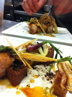 Chef Paul Qui's pork belly, onion, black lime, coriander blossoms.