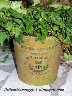 """Beautiful planter created by Little Miss Maggie.  Faux-finished terra cotta pot, Graphics Fairy French typography image, reversed, and printed on a laser printer.  Mod Podge used as a transfer medium.  Allowed to dry overnight;  Transfer image paper is wetted and damp cloth used to remove paper """"label"""".  Once dried, steel wool used to """"age"""" painted finish and transfer image.  Steel wool residue cleaned off and protective top coat applied."""