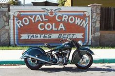 1948 Indian Chief in front of vintage sign