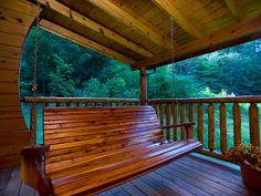 Log home porch swing