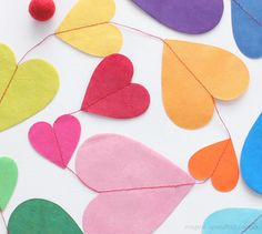 Paper Heart Garland from Upon A Fold. Like the variation of size/color.