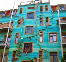 This building is located in Dresden, Germany. It's called Neustadt Kunsthofpassage. When it rains it starts to play music.