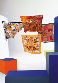 "Fall-Winter 2012 Hermès silk collection  Silk twill scarves ""Casques et plumets"", ""Tigre du bengale"", ""Camails"" and ""L'instruction du roy"".  Photo : Nathaniel Goldberg"