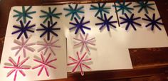 Popsicle glitter snowflakes.  For disney frozen party.  Made with colored popsicle sticks,  white Acrylic paint, glitter glue and home made glitter mod podge.  Hot glue gun the sticks together than line with glitter glue.