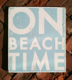 on beach time sign