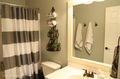 Silver Sage paint by Restoration Hardware / West Elm Striped Shower Curtain