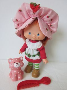 Strawberry Shortcake Doll and Pet Custard My favorite red head ever!!! Such a sweet character. Innocent and pure as kids toys should be