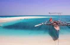 This exquisitely fine sand bar off the shores of the mystic island of Camiguin, Philippines is so inviting you won't mind getting tanned on a hot, summer day.