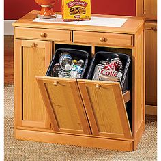 3-Bin Recycling Cabinet  - 2 drawers for storing trashbags, etc.  Tilt-out doors with removable plastic waste bins.