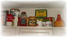 eclectic kitchen by Lisa's Creative Designs    Another idea is old fashioned tins.