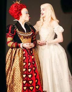 Helena Bonham Carter and Anne Hathaway as The Red Queen and The White Queen in Alice in Wonderland