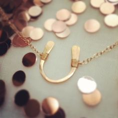 Lucky rose gold horseshoe necklace by Olive Yew