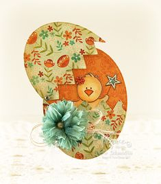 handmade Easter card ... clever design: shape of egg with hinged top that lifts up and shows a chick inside ...