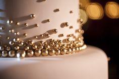Gold metallic balls on wedding cake