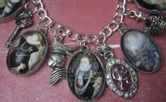 Silver tone Queen Elizabeth I Charm Bracelet. $45.00. Etsy link: http://www.etsy.com/listing/102784509/beautiful-queen-elizabeth-i-charm?ref=sr_gallery_6_search_query=queen+elizabeth+i_view_type=gallery_ship_to=ZZ_min=0_max=0_search_type=all#