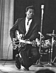 Chuck Berry demonstrating his famous duck walk.