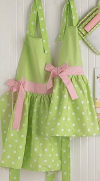green and pink polkadot apron