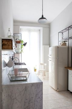 Intimate and cozy kitchen with carrara marble.