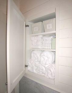 recessed storage using an off the shelf pottery barn medicine cabinet   Doug Davis, Tracery Interiors