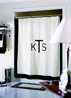 A DIY-er project to make a Monogram Shower Curtain (http://www.diyideas.com/quickprojects/Accents/easymonogramideas_ss7.htm)