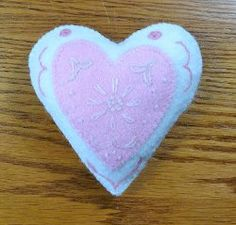 Embroidery Heart Pincushion. Show your love for someone special this Valentine's Day with an Embroidery Heart Pincushion. You'll find the hand embroidery techniques used in this tutorial to be great practice for future projects, and the results will be a beautiful little Valentine's Day sewing project you can use yourself or give as a gift.