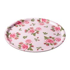 """Barbar"" pink round serving tray with rose floral print from Ikea ($8)."
