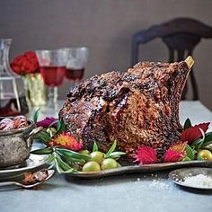 Standing Rib Roast with Red Wine Mushrooms | Start roasting at 450º for 45 minutes to form the caramelized crust. Then reduce the temperature and finish cooking to keep the inside pink and juicy. | SouthernLiving.com