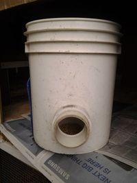 automatic chicken feeder in a 5-gallon bucket